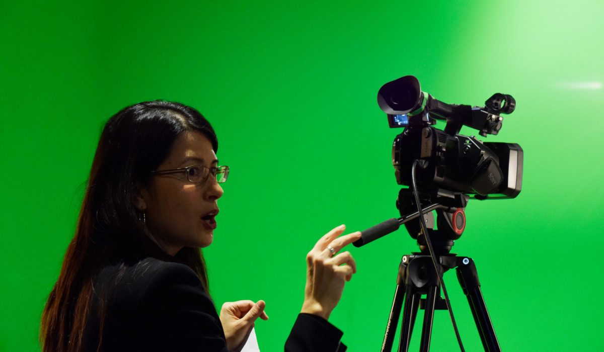 Pictured: Professor Takesue utilizing the Video Production Studio at Express Newark. c/o Gustavo Morais